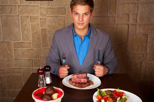 man-at-restaurant-eating-steak-fb